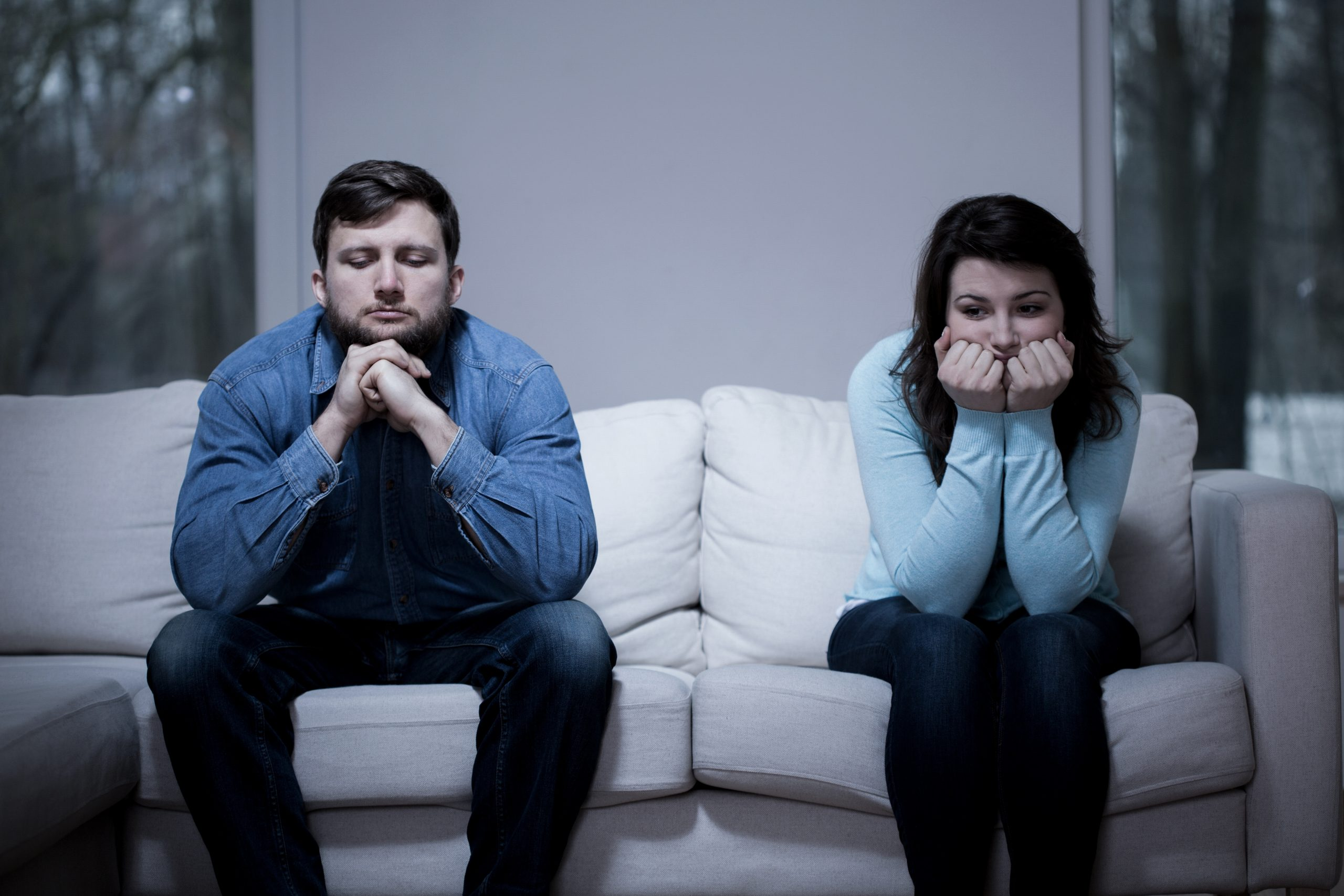 A couple having marriage problems is discussing divorce mediation with a Rochester NY attorney